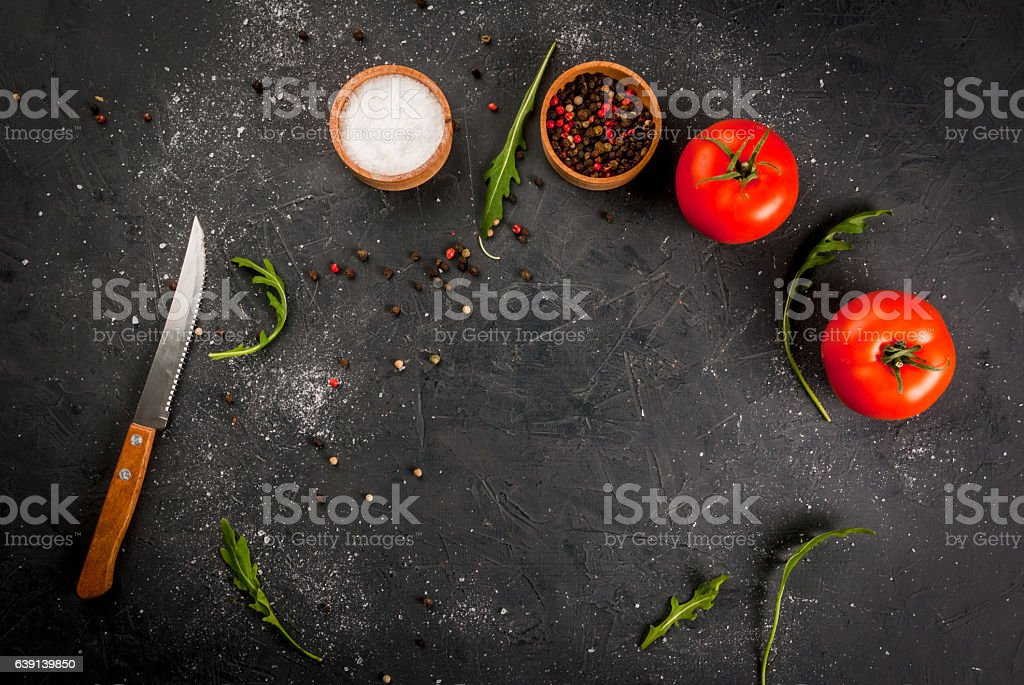 Kitchen table with a knife, spices & herbs stock photo