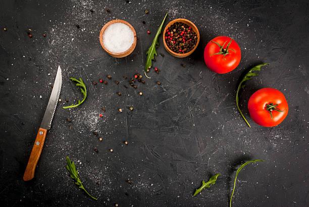 kitchen table with a knife, spices & herbs - speisesalz stock-fotos und bilder