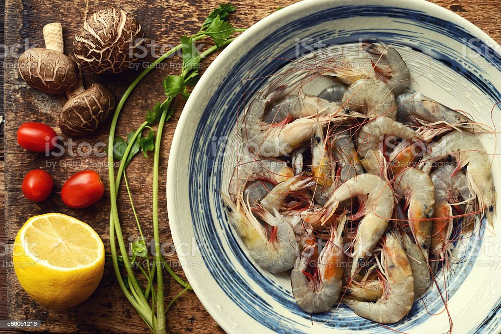 Kitchen table with raw ingredients for preparing fresh seafood stock photo