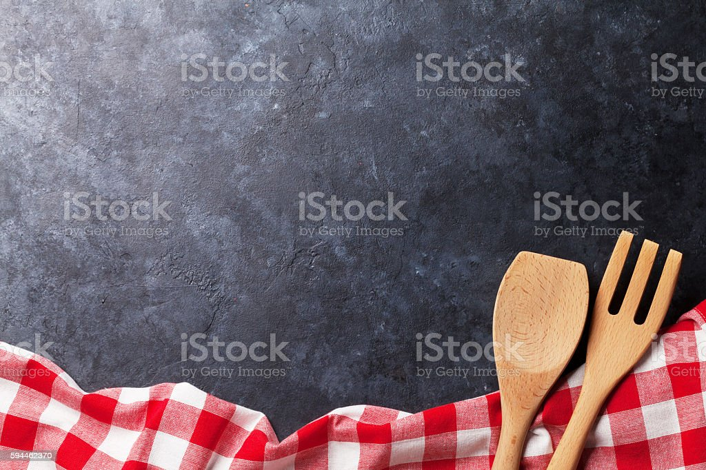 Kitchen table with towel and utensil - Photo
