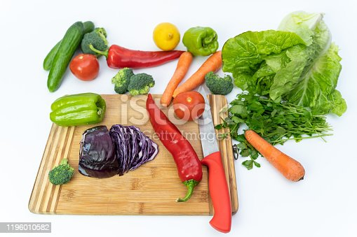 923629650 istock photo Kitchen table with vegetables and cutting board for preparing salad 1196010582