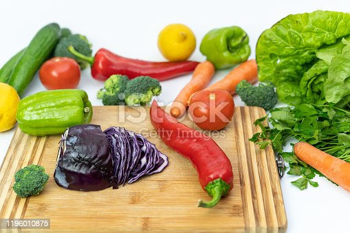 923629650 istock photo Kitchen table with vegetables and cutting board for preparing salad 1196010875