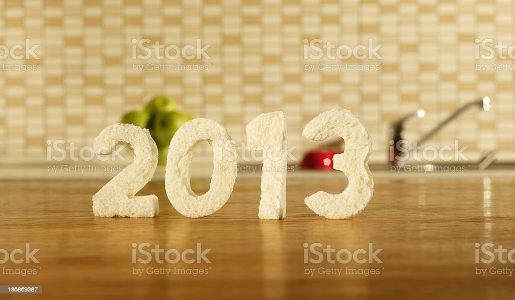 Kitchen table, written 2013 with Bread royalty-free stock photo