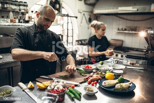 Cooks preparing sea specialties in the restaurant kitchen