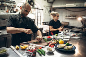 Cooks preparing sea specialties in the restaurant kitchen