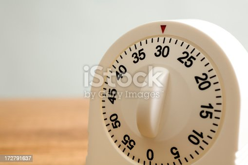Kitchen timer on wooden counter.  MORE LIKE THIS... in lightboxes below!