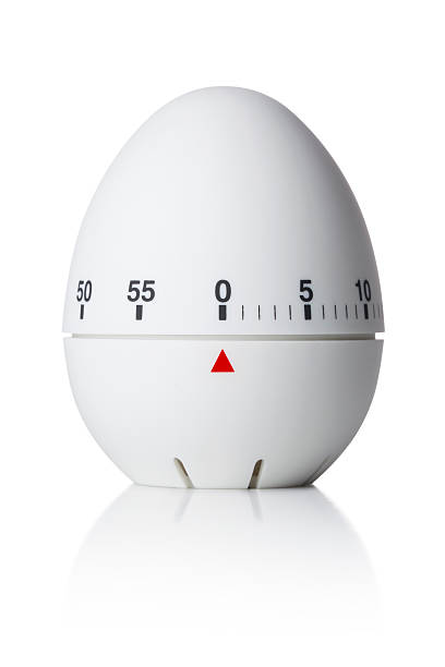 Kitchen timer Kitchen egg timer. Photo with clipping path. timer stock pictures, royalty-free photos & images