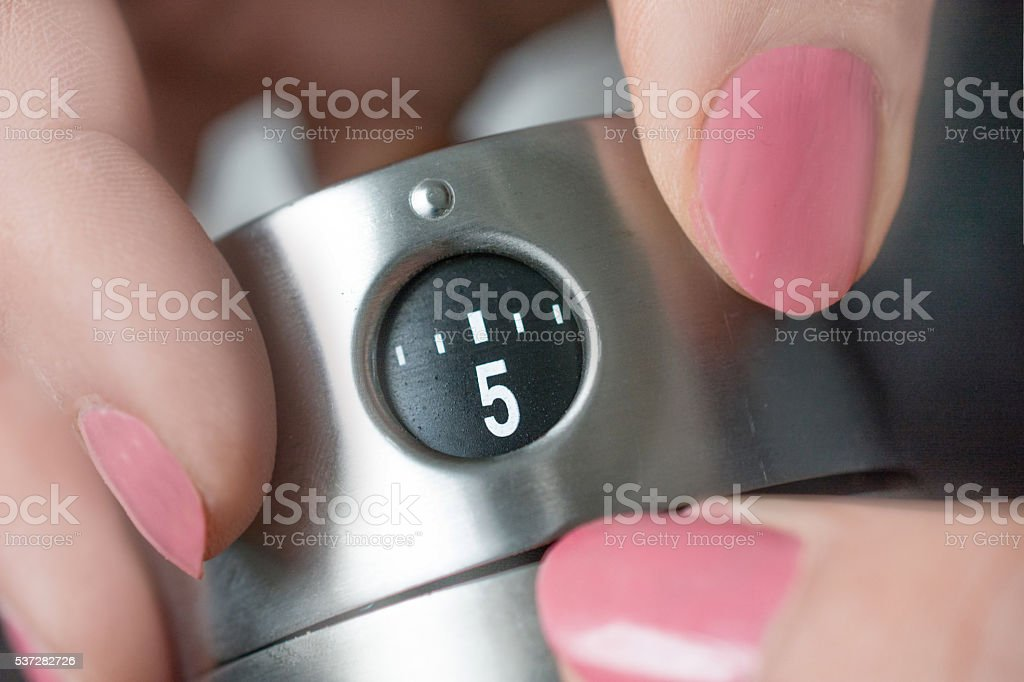 Kitchen timer set to 5 minutes stock photo