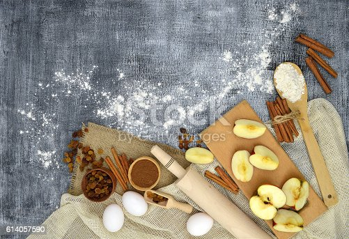istock Kitchen tools and products for baking on a dark background. 614057590