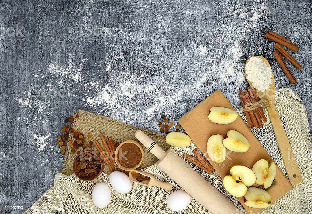 Kitchen tools and products for baking on a dark background. stock photo