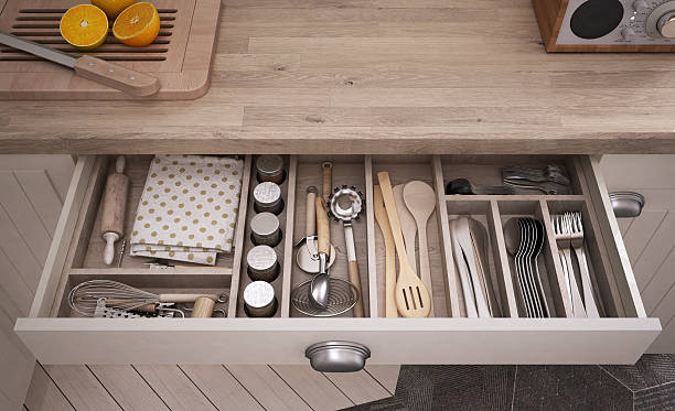 Kitchen tools in an open drawer stock photo