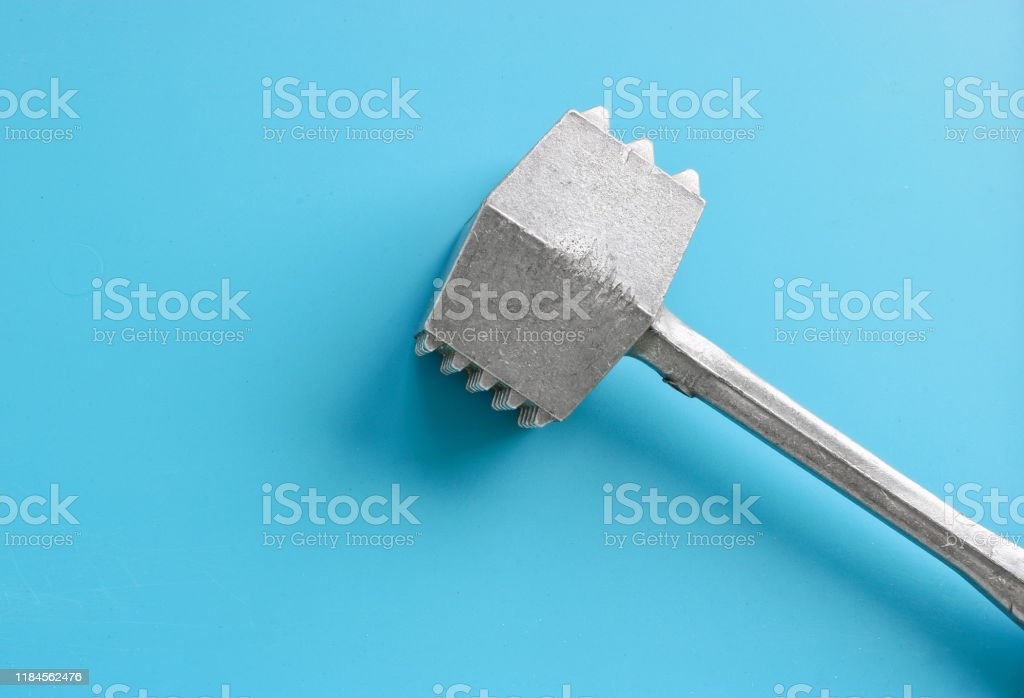 Kitchen Utensils A Hammer For Beating Meat On A Blue Background Tools For Cooking Raw Food Stock Photo Download Image Now Istock