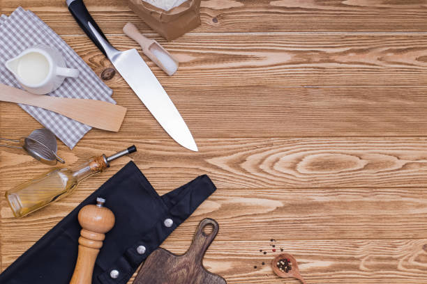Kitchen utensils and accessories on wooden table with copy space. stock photo