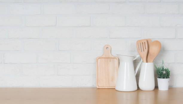 Kitchen utensils and dishware on wooden shelf. Kitchen interior background.Text space. Kitchen utensils and dishware on wooden shelf. Kitchen interior background.Text space. dining table stock pictures, royalty-free photos & images