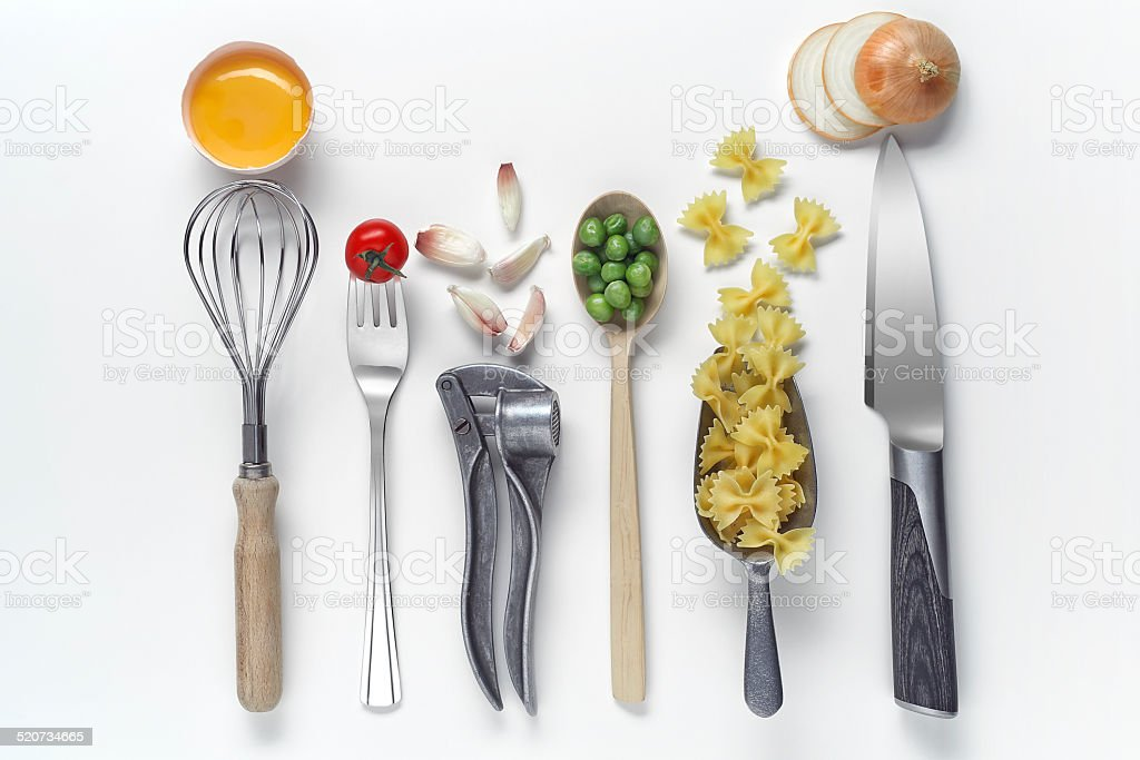 Kitchen utensils and raw foods on white background. stock photo