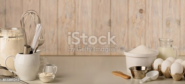 istock Kitchen utensils and tools for homemade baking on a light wooden background. 853351012