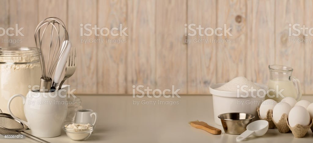 Kitchen utensils and tools for homemade baking on a light wooden background. stock photo