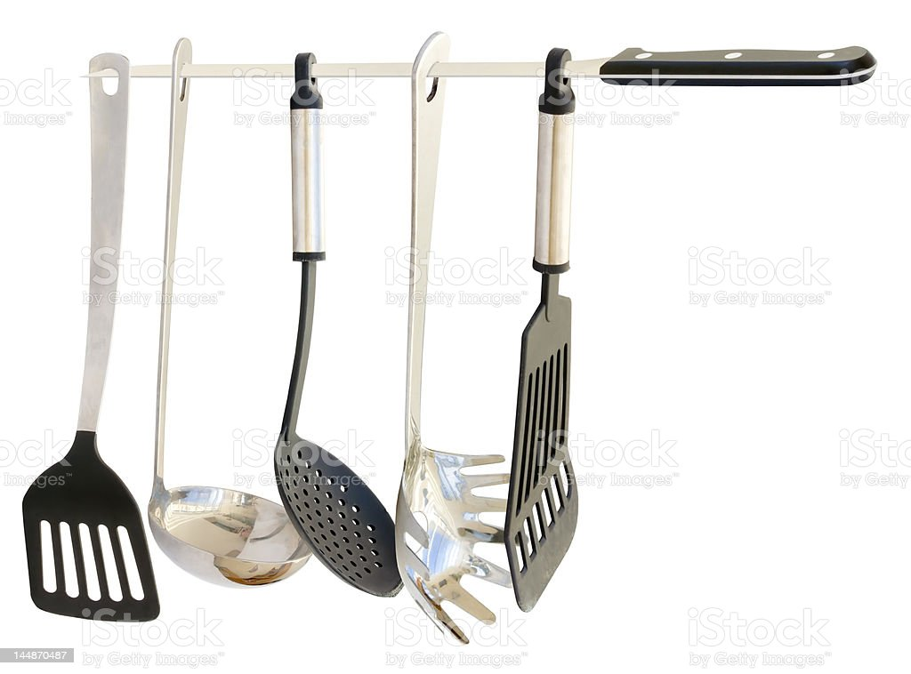 Kitchen Utensils hanging from a carving knife stock photo