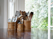 istock Kitchen utensils in containers on table 77932058