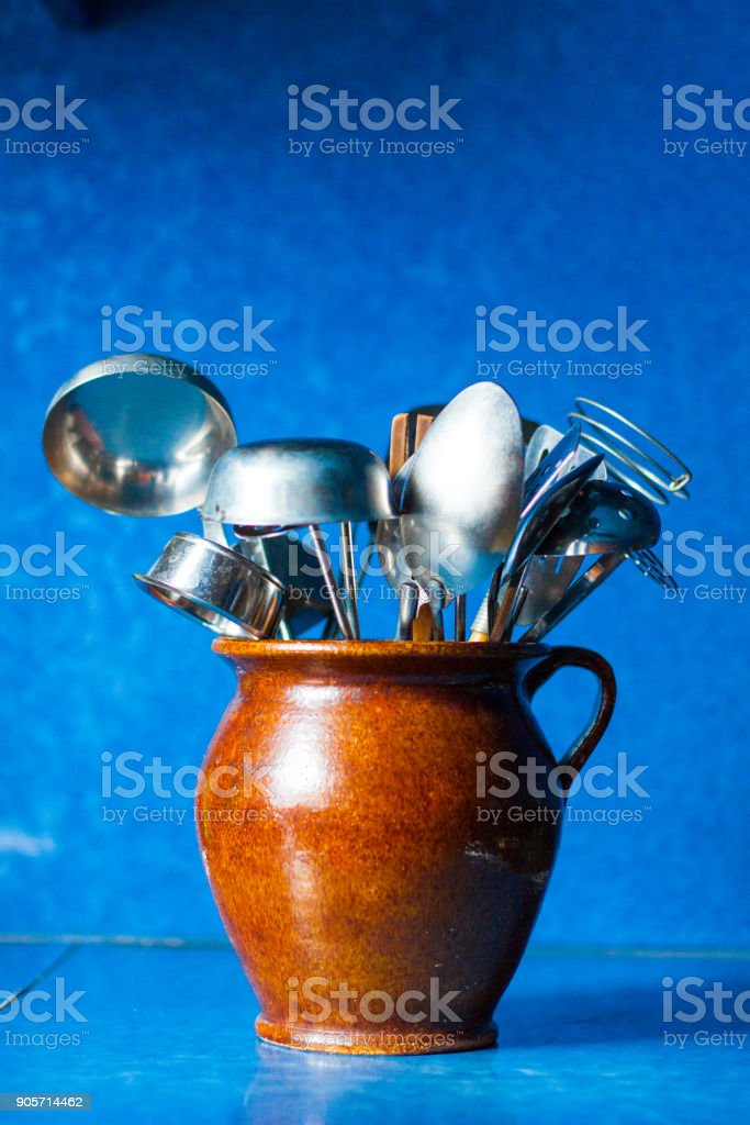 Kitchen utensils on blue background stock photo