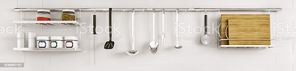 Kitchen utensils on the tiled wall 3d render stock photo