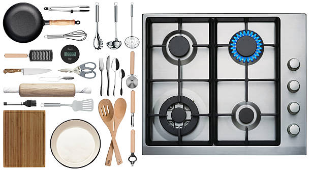 Kitchen utensils on white background top view stock photo
