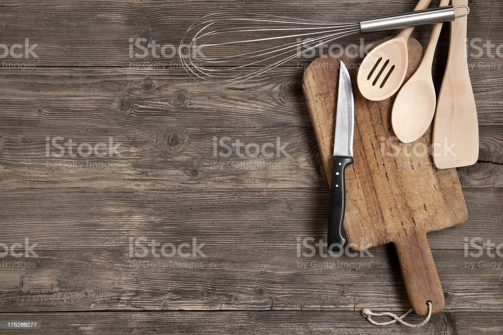 Kitchen utensils on wooden table stock photo