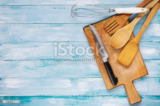 Kitchen utensils on blue wooden table