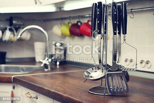 839034546 istock photo Kitchen utensils on  work top 843324876