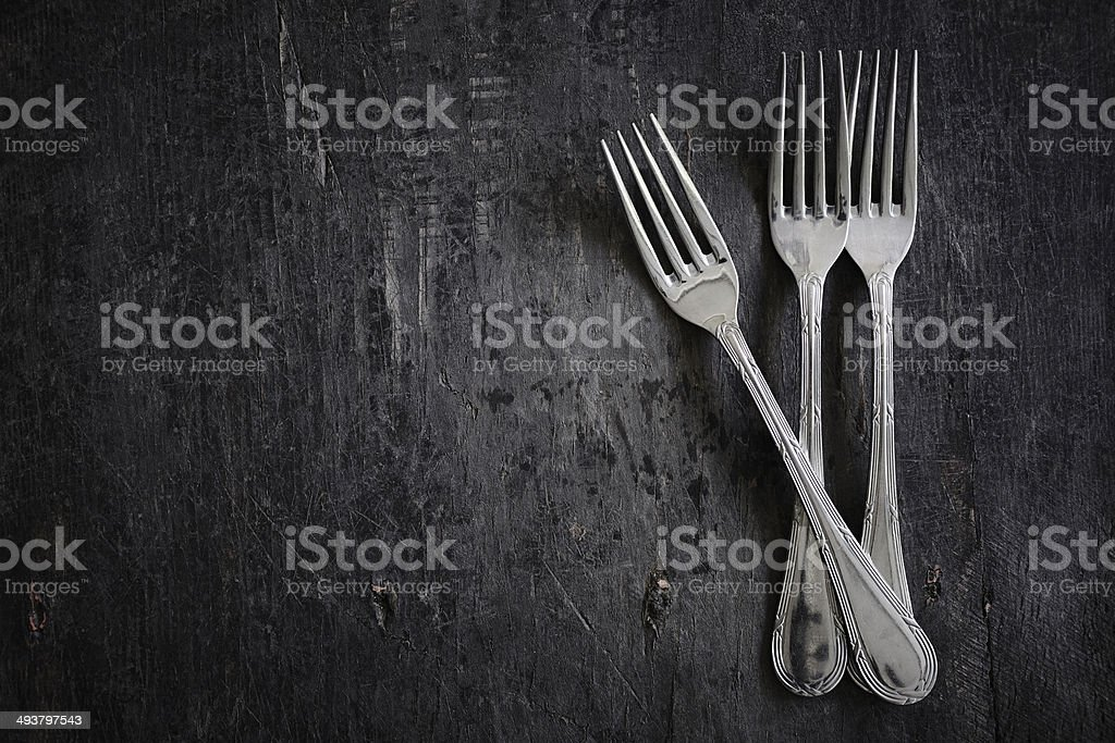 Kitchen utensils - Silver forks on dark wooden table stock photo
