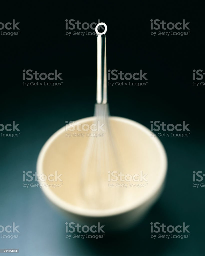 Kitchen Utensils Whisk and Mixing Bowl royalty-free stock photo