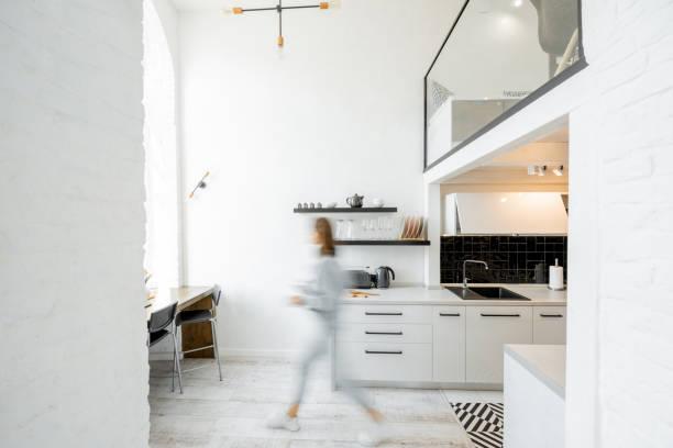 Kitchen with blurred human figure stock photo