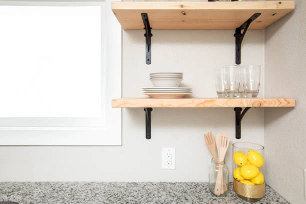 Kitchen With Floating Shelves Wooden floating shelves in a modern kitchen space afloat stock pictures, royalty-free photos & images