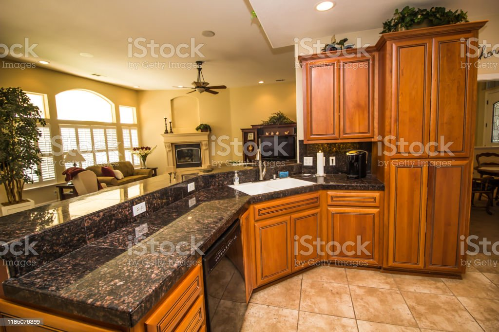 Kitchen With Granite Counters And Wood Cabinets Stock Photo Download Image Now Istock