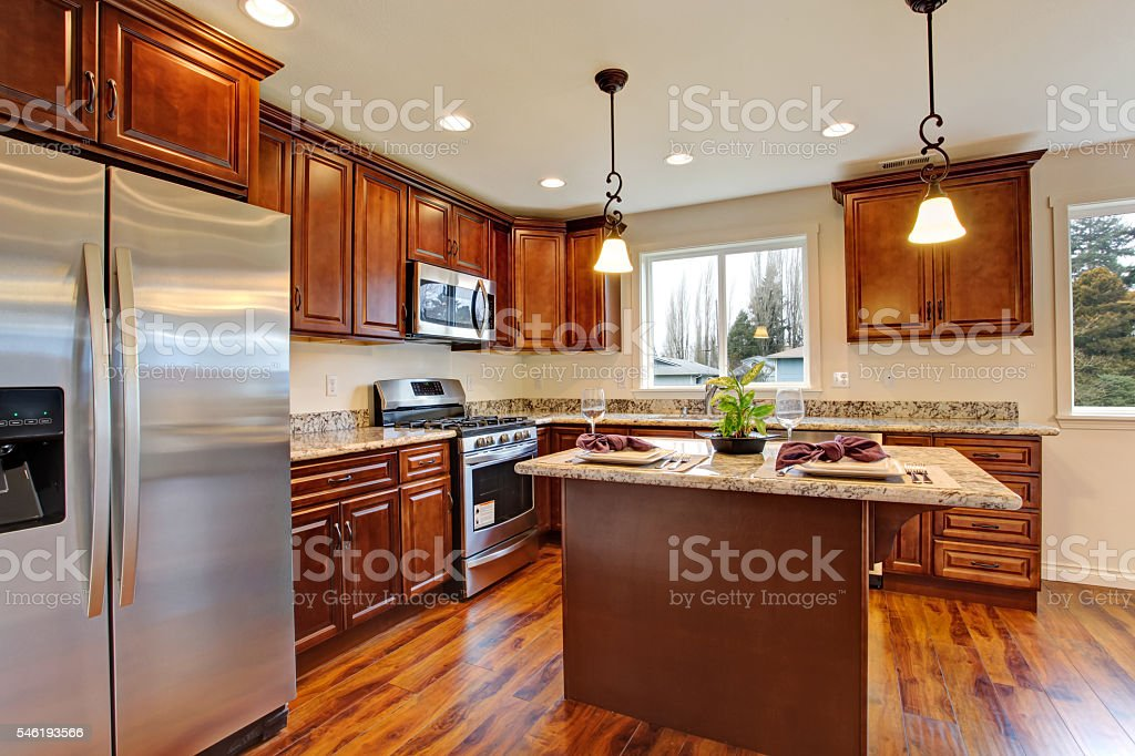 Kitchen with hardwood floor and granite counter tops. stock photo