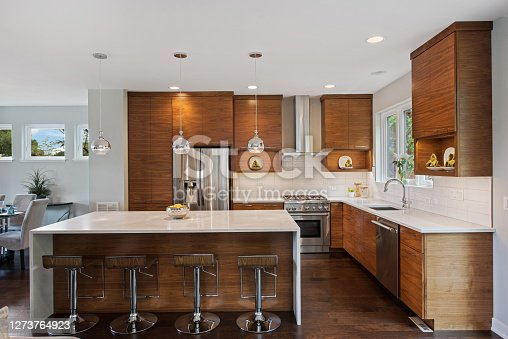 istock Kitchen with natural wood cabinets 1273764923