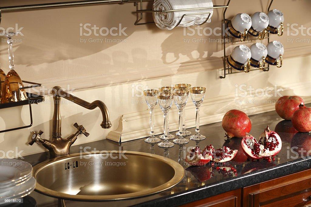 Kitchen with pomegranates royalty-free stock photo