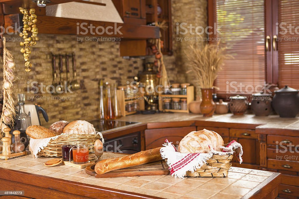 Kitchen with various breads on the counter stock photo