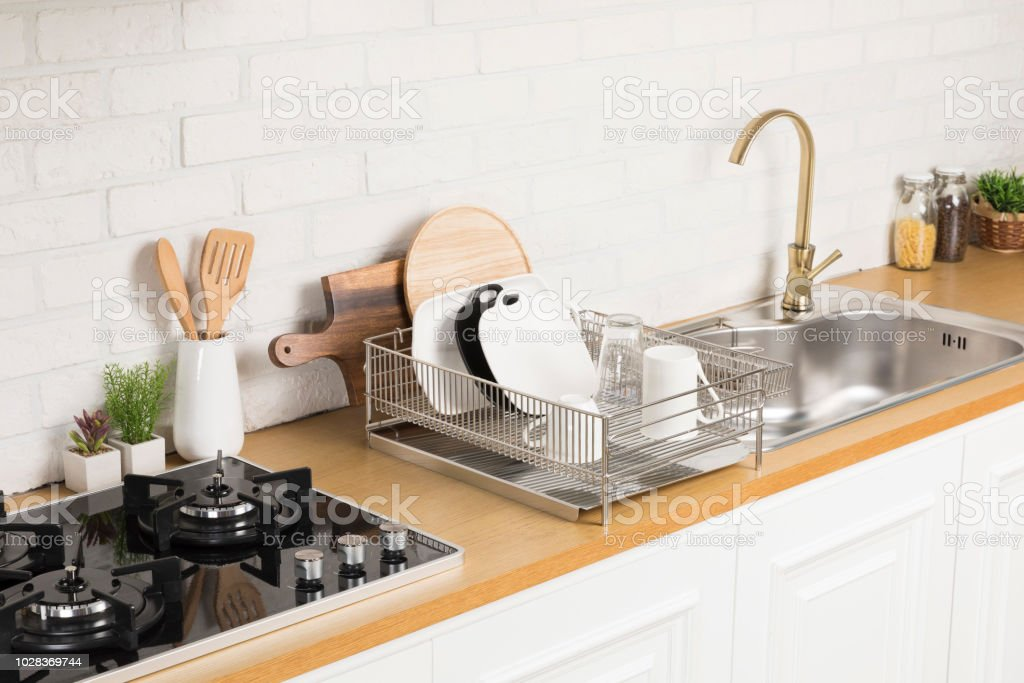 Kitchen With Various Kitchen Tools Background With Kitchen Racks And Plants  The Appearance Of Drying Dishes And Bowls Stock Photo - Download Image Now
