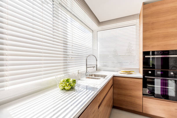 Kitchen with white window blinds stock photo