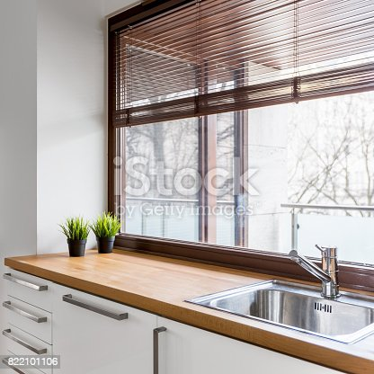 istock Kitchen with wooden countertop 822101106