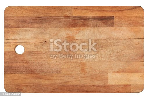 top view closeup of used wooden kitchen cutting woodboard isolated on white background
