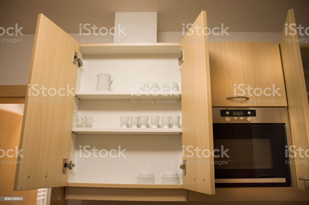 Kitchenware and cupboard in drawer europe style in kitchen room stock photo