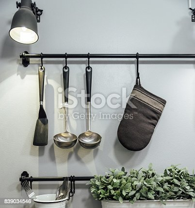 istock Kitchenware and tree hanging on the wall. 839034546