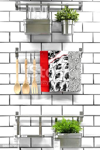 839034546 istock photo Kitchenware hanging on a wall 686487954