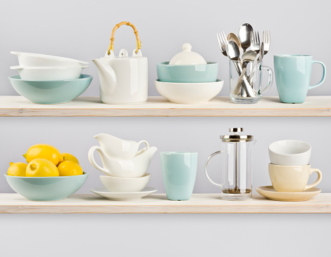 Kitchenware on wooden shelves