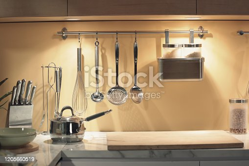 839034546 istock photo kitchenwares hanging on the wall 1205660519