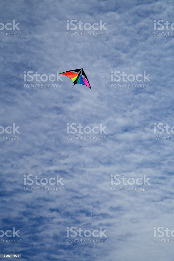 Kite against an clouded sky royalty-free stock photo