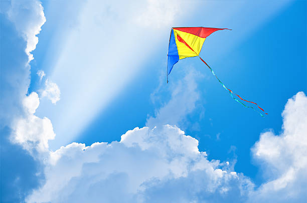 Kite flying in the sky among the clouds - foto stock