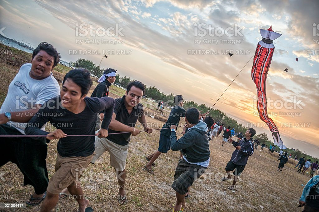 Kite Flying on Sanur Beach at Sunset stock photo